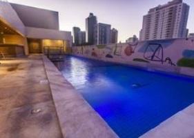 ALT = piscina e servizi Holiday Inn Natal